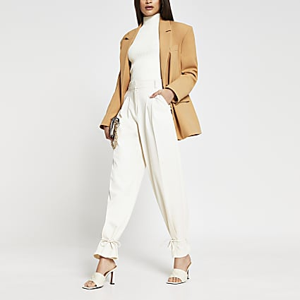 Cream cinched hem trousers
