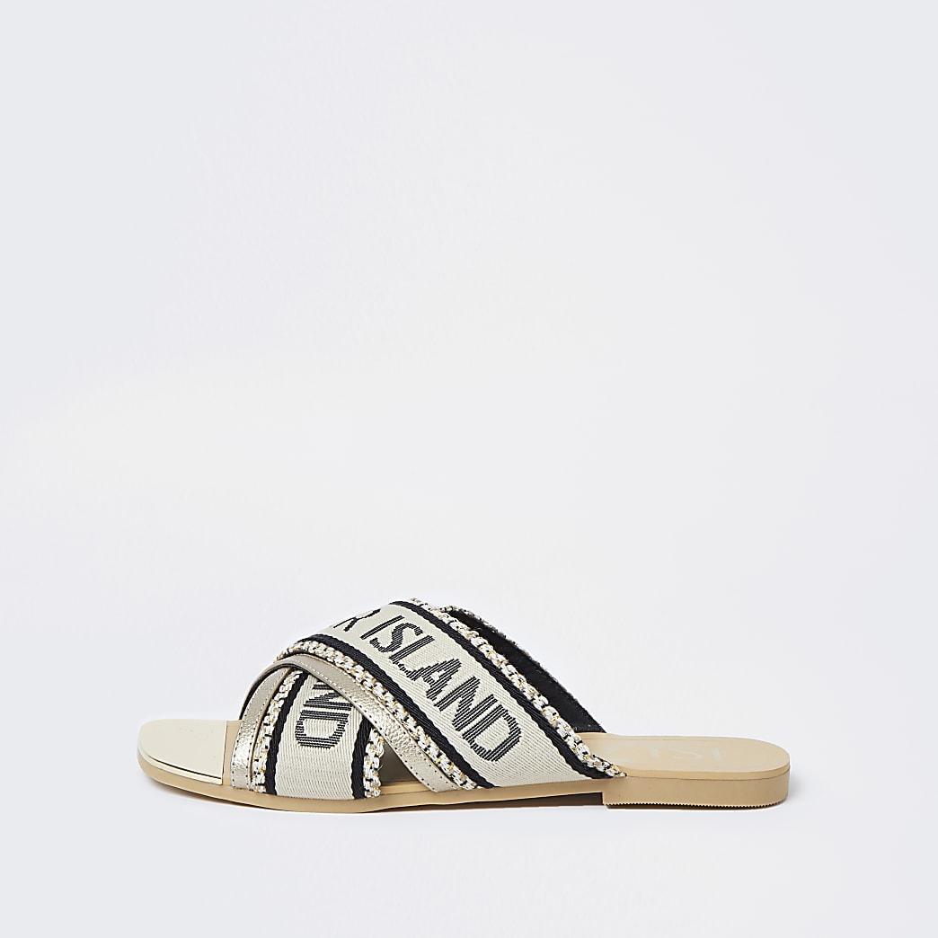 Cream cross over flat sandals