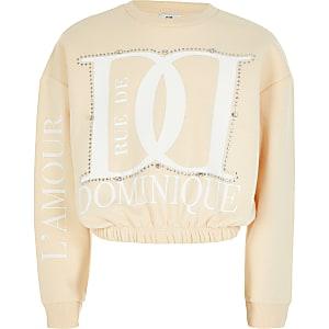 Crèmekleurige sweater met 'Dominique'-print en siersteentjes