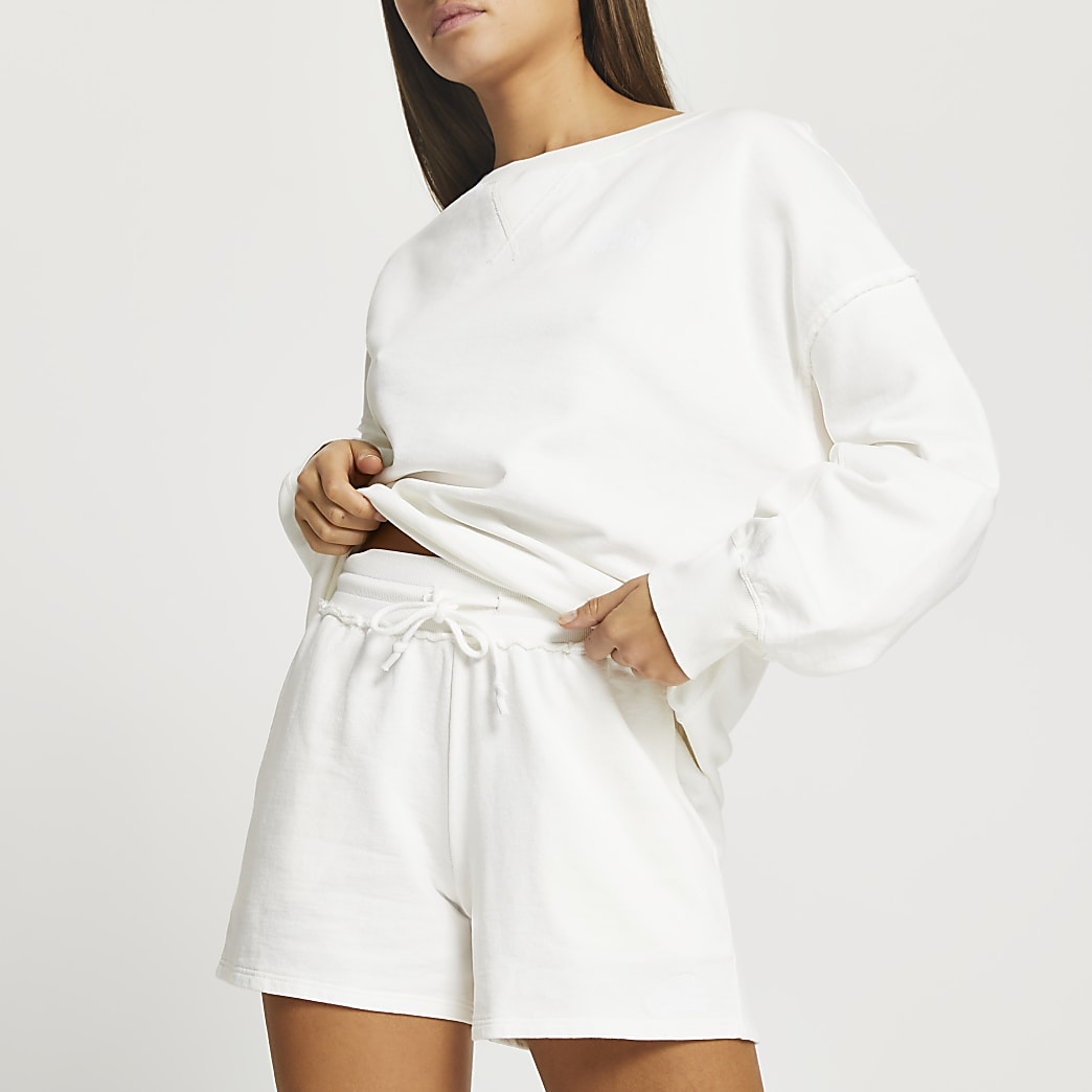 Cream elasticated runner shorts
