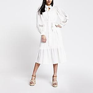 Crèmekleurige geborduurde midi-jurk met lange mouwen