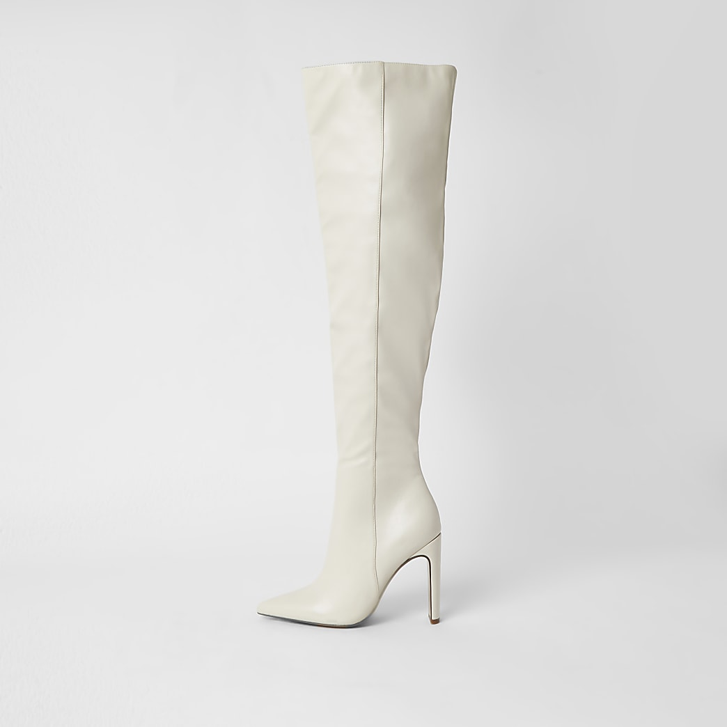 Cream faux leather pull on high leg boots