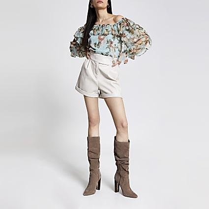 Cream faux leather tab waist shorts