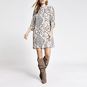 Crèmekleurige geplooide mini-jurk met bloemenprint