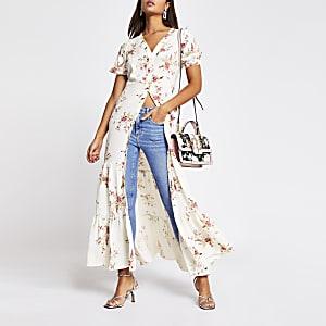 Crèmekleurige midi-jurk met bloemenprint en korte mouwen
