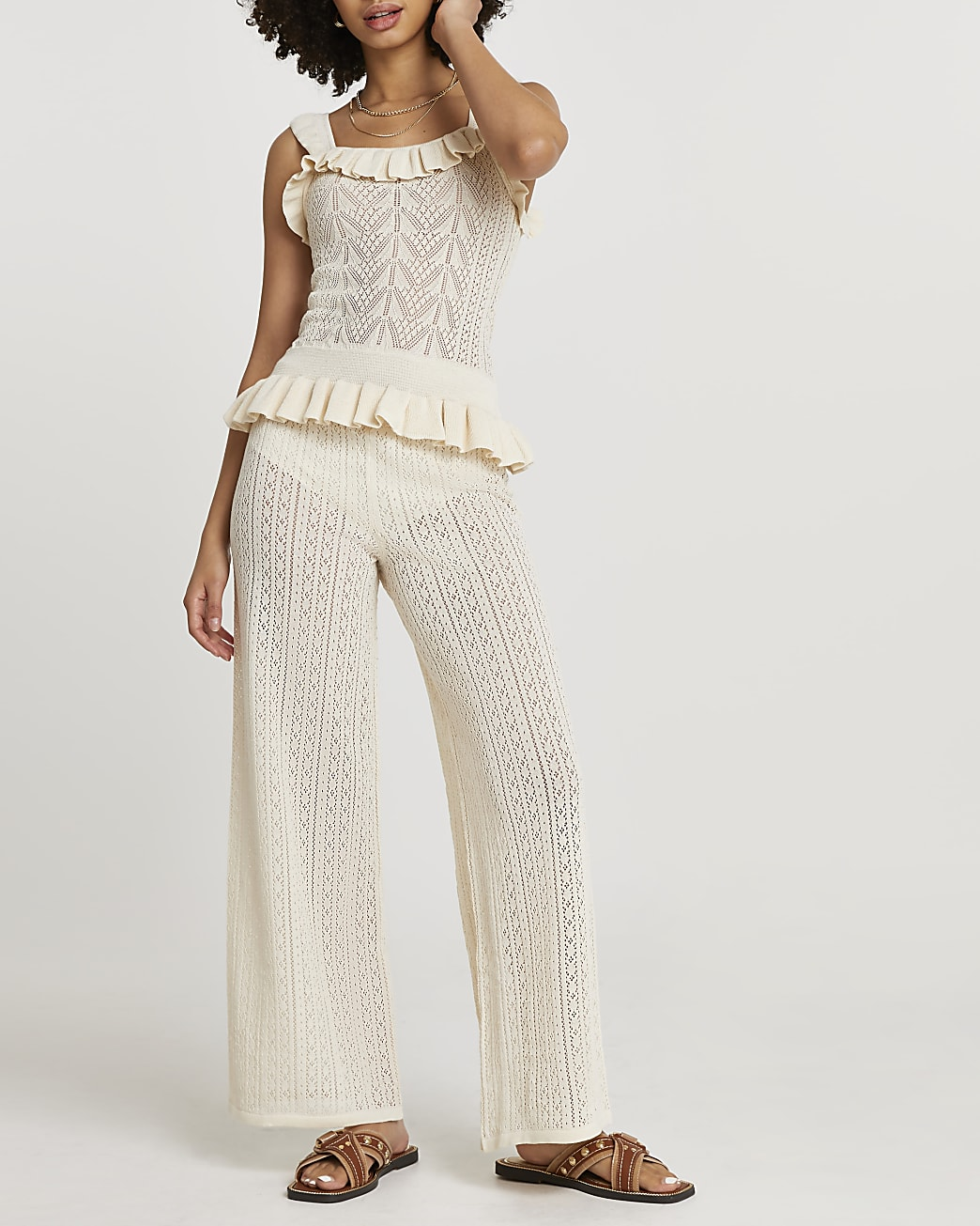 Cream frill hem knitted trousers