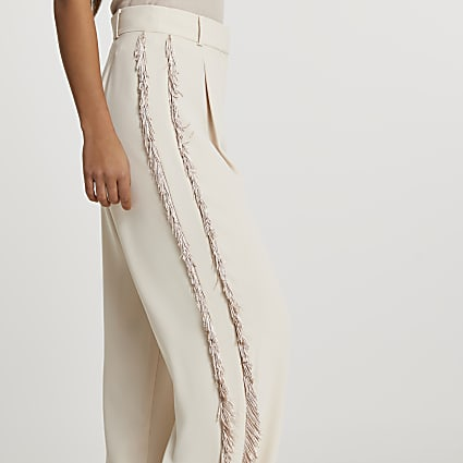 Cream fringe side trousers