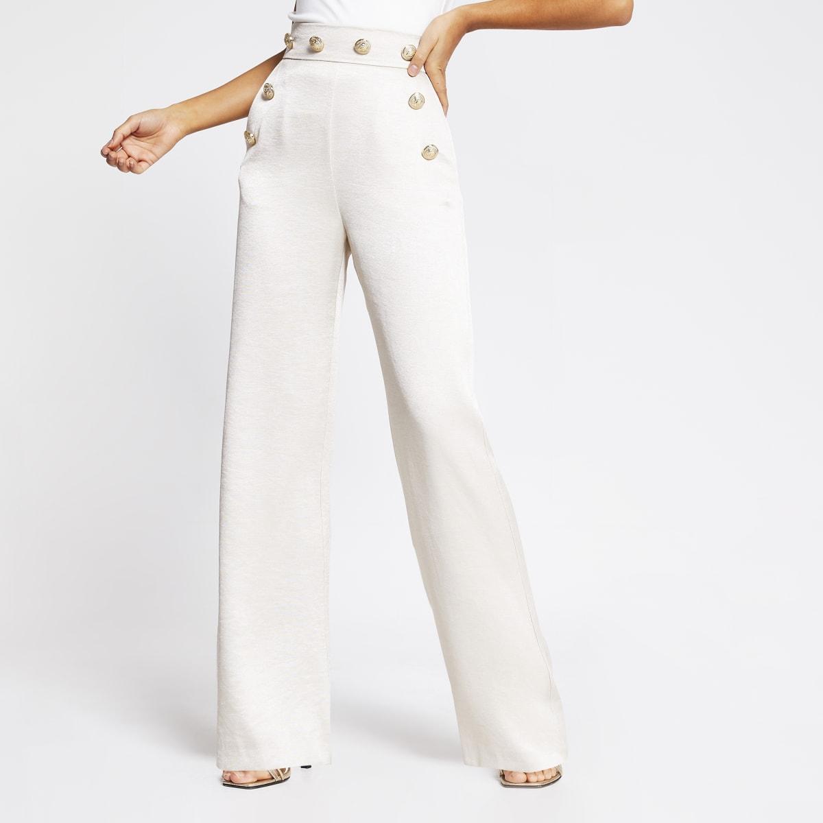 Crèmekleurige high waist broek met knopen en wijde pijpen