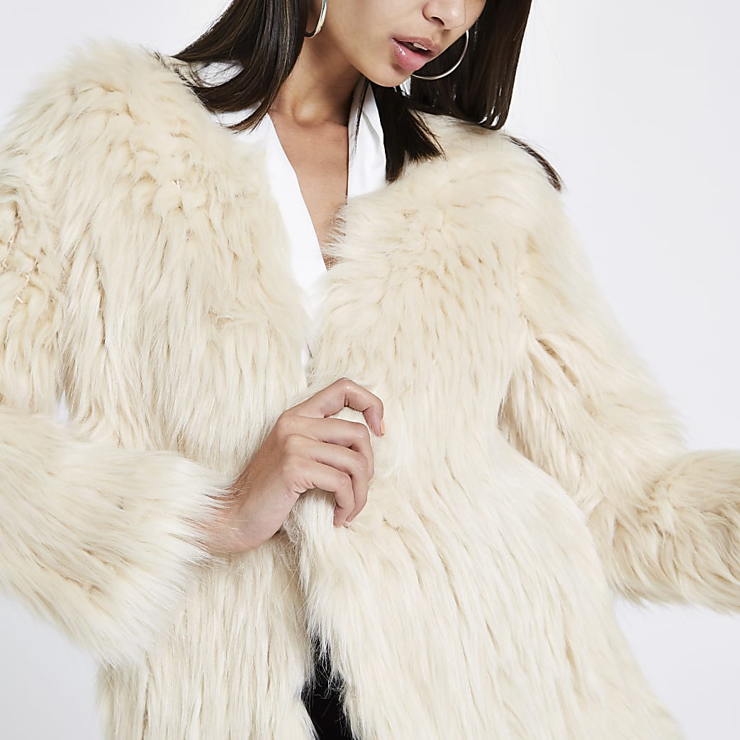 Cream knitted faux fur coat