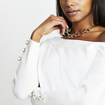 Cream long sleeve asymmetric knit top