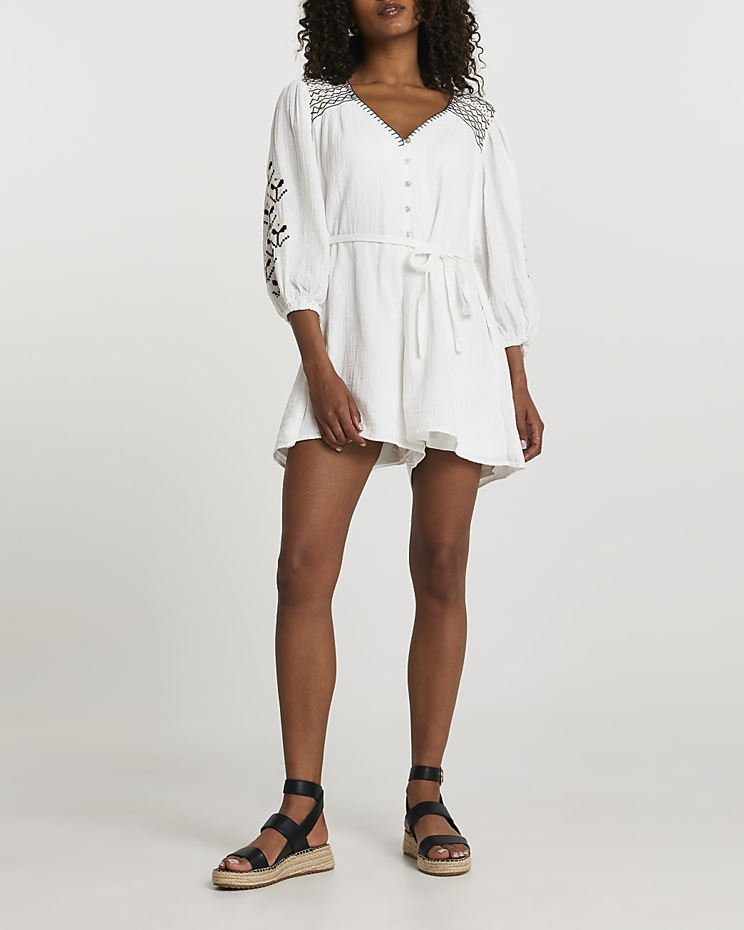 Cream long sleeve embroidered romper