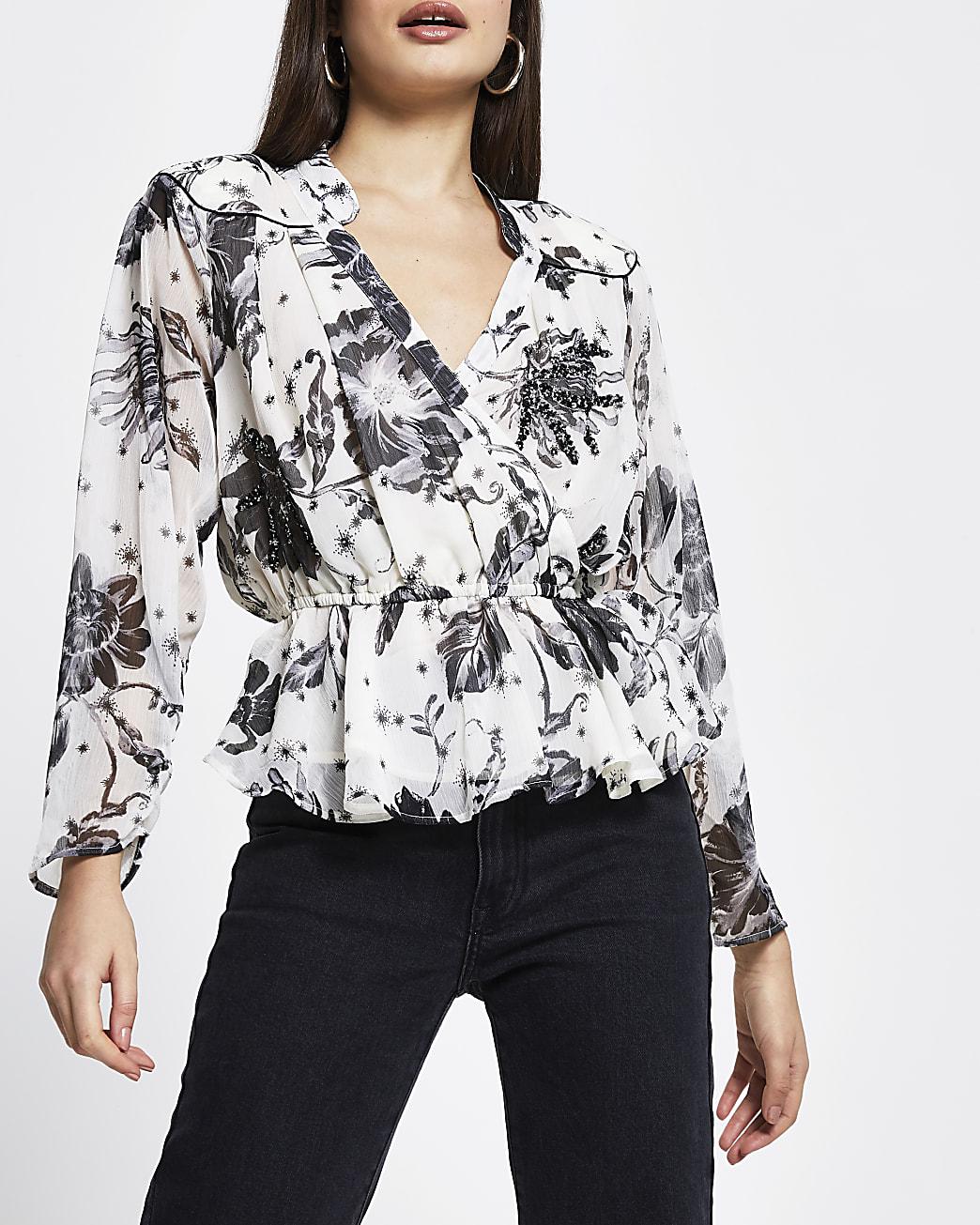 Cream long sleeve peplum wrap floral blouse