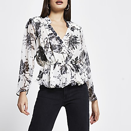 Cream long sleeve peplum wrap floral blouse