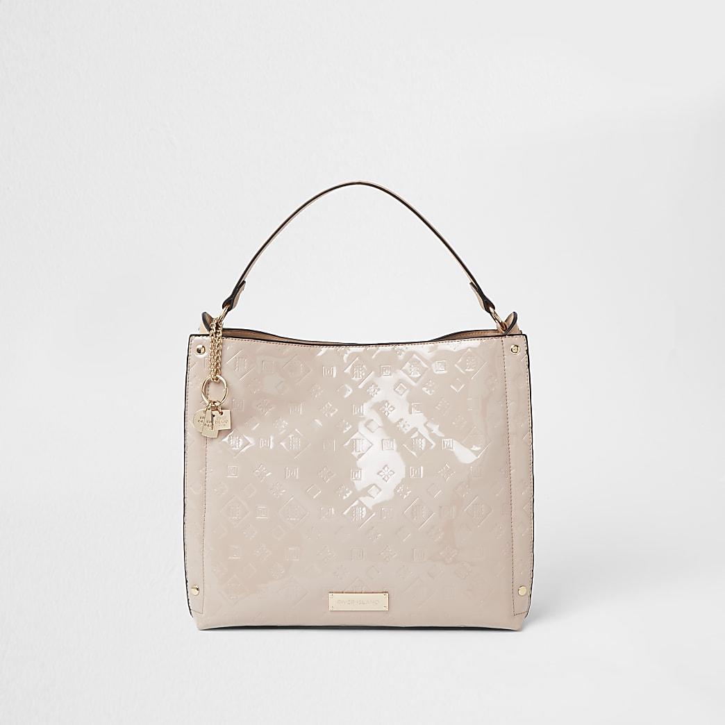Cream patent embossed slouch handbag