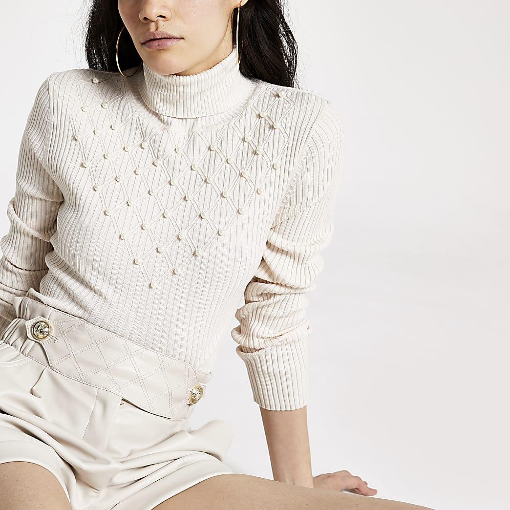 Pull en tricot couleur perle à col roulé