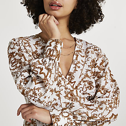 Cream printed long sleeve blouse top