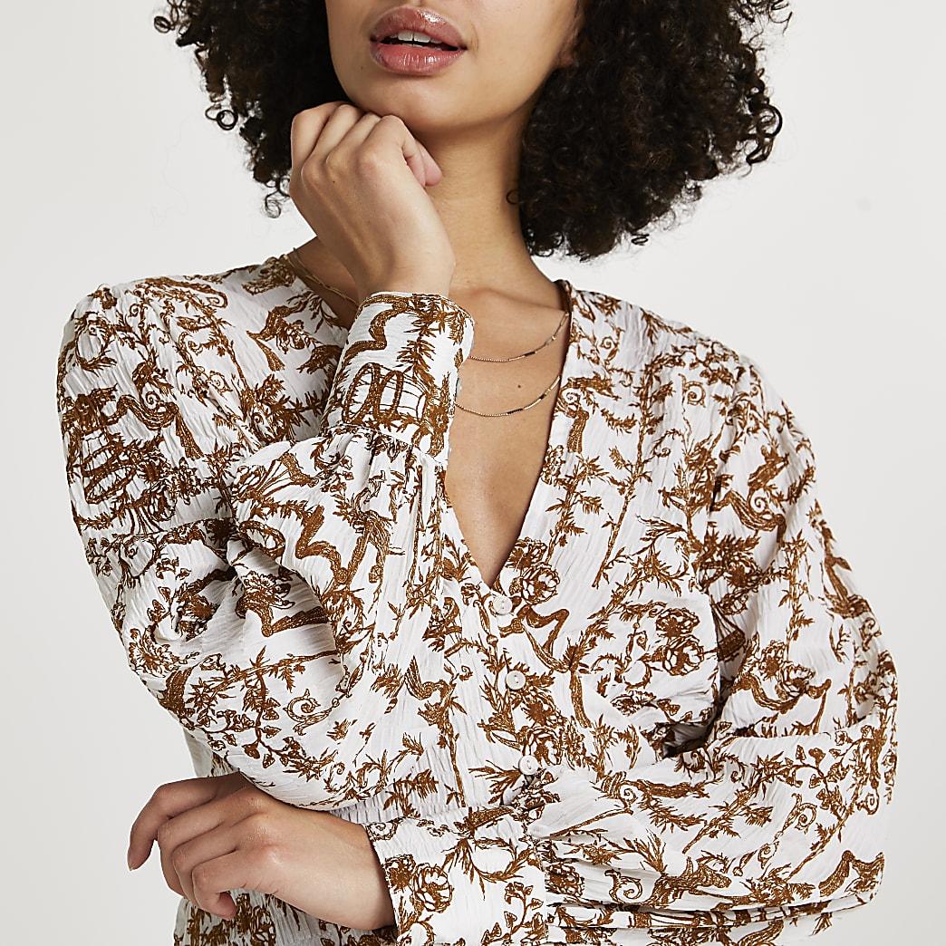 Cream printed long sleeve blouse top