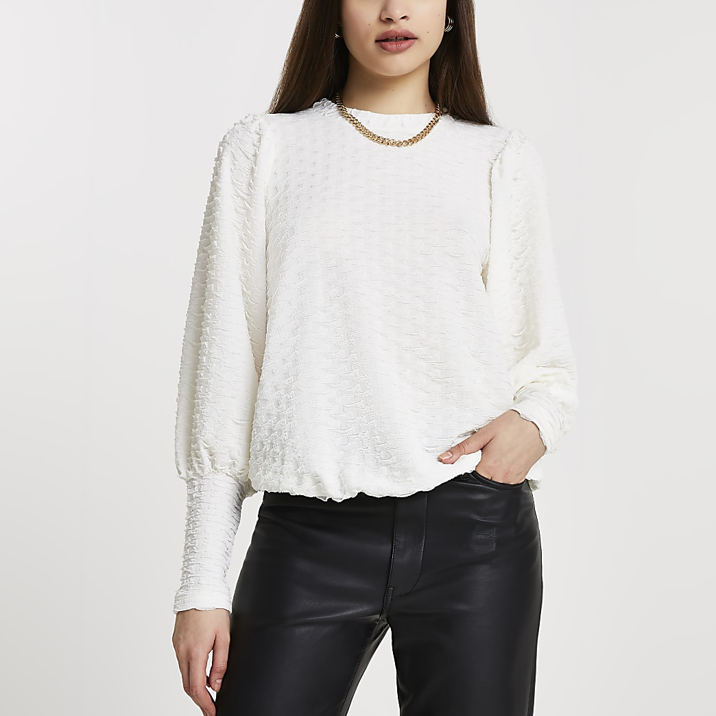 Cream puff sleeve textured top