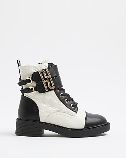 Cream quilted lace up buckle boots