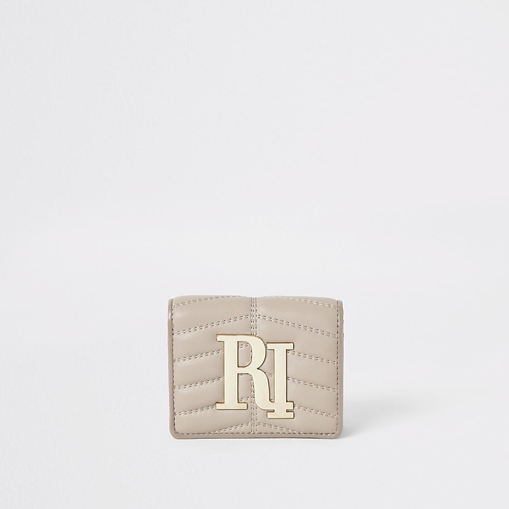 Cream quilted RI foldout purse