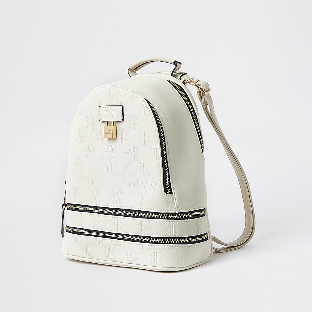 Cream RI embossed monogram backpack