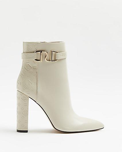 Cream RI monogram embossed heeled boots