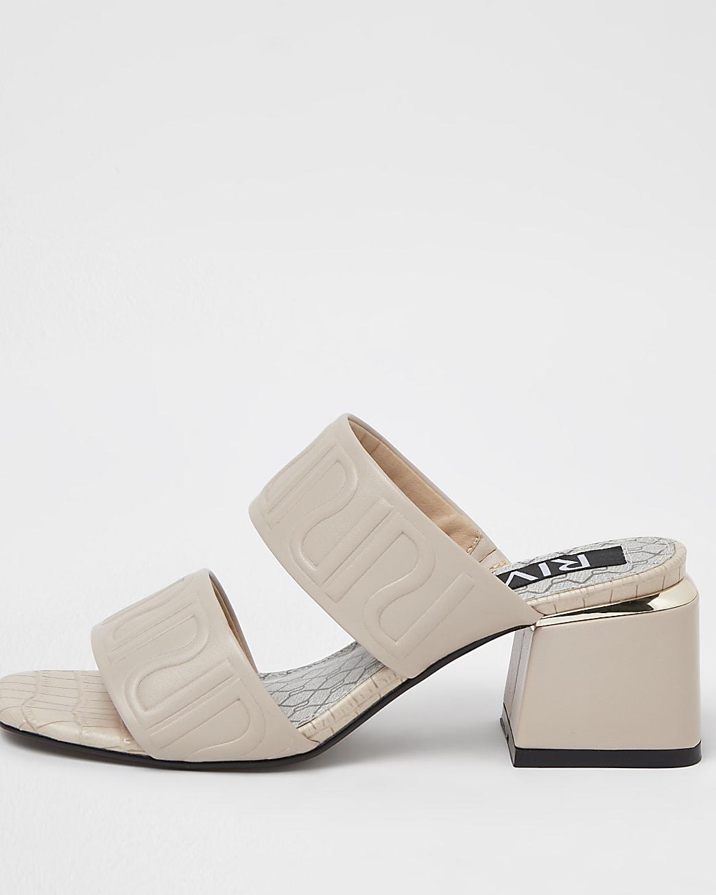 Cream RI monogram heeled mules