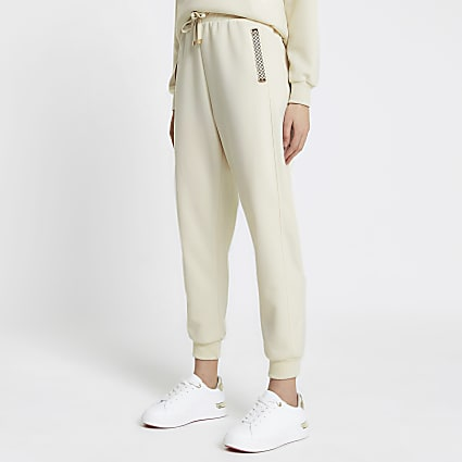 Cream RI monogram trim neoprene joggers