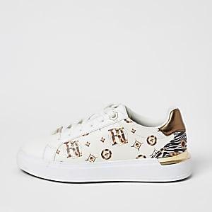 Crèmekleurige sneakers met vetersluiting en RI-print