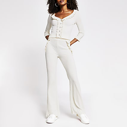Cream rib pearl button flare trouser
