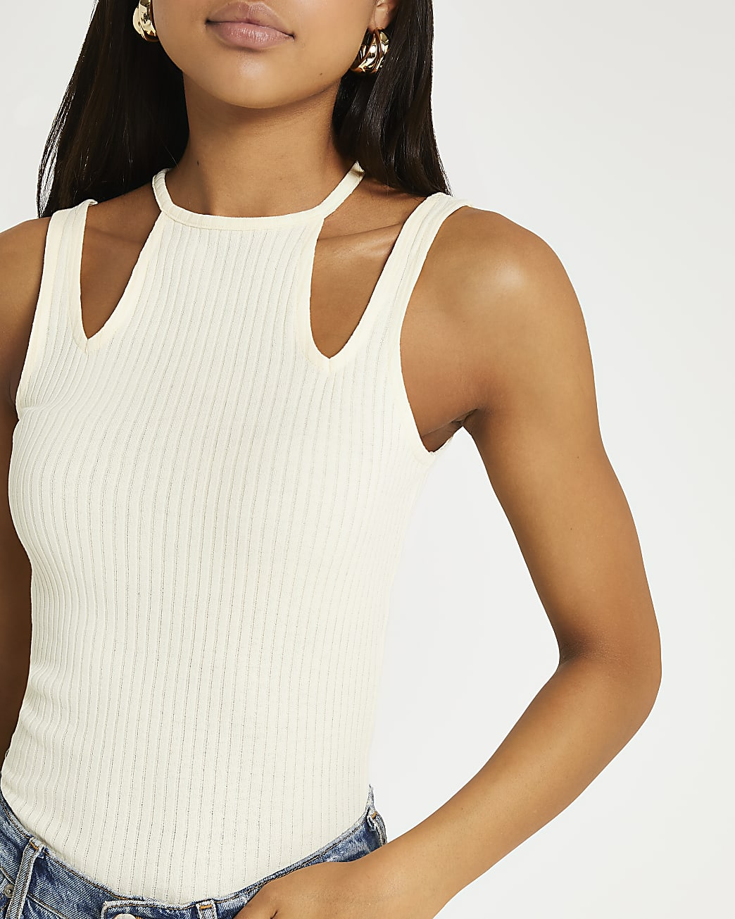 Cream ribbed cut out neck vest top
