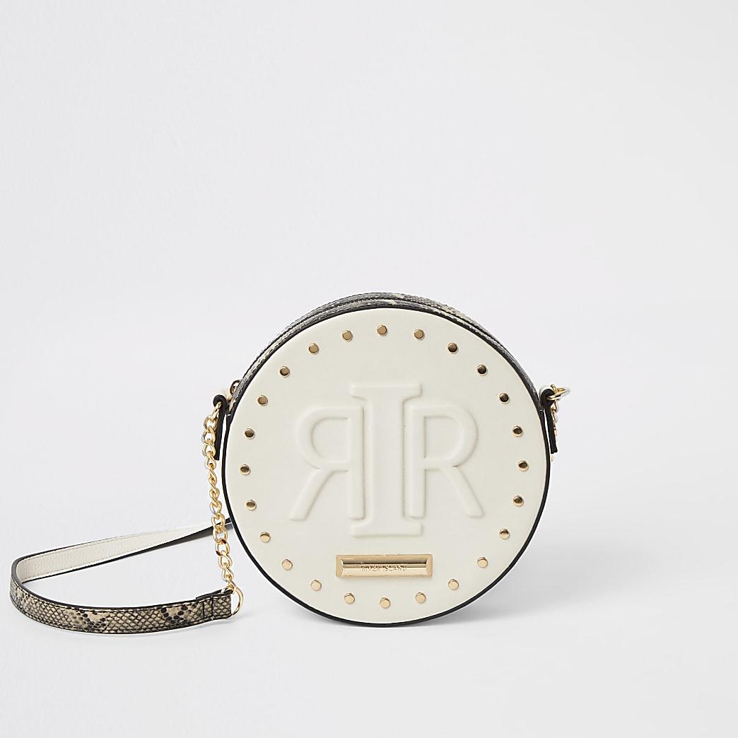 Cream RIR embossed circle cross body bag