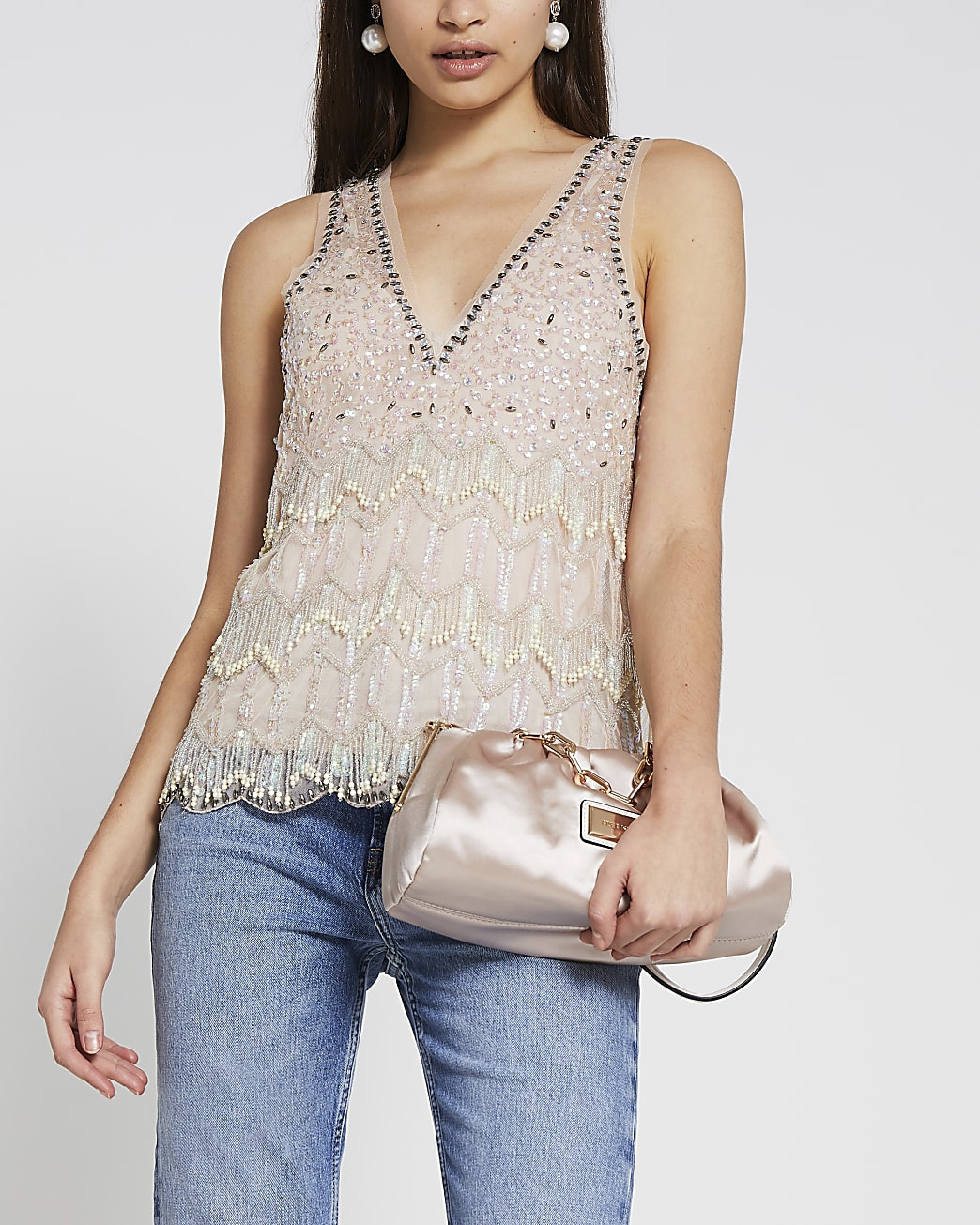 Cream sleeveless embellished vest top