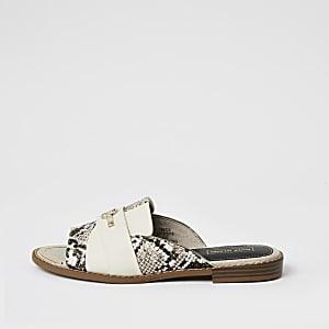 Crèmekleurige slip-on sandalen met slangenprint en RI-embleem