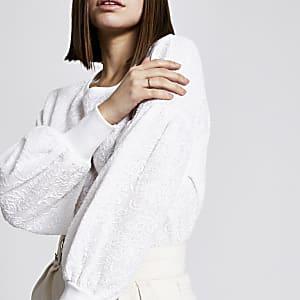 Crèmekleurige sweater met getextureerde pofmouwen