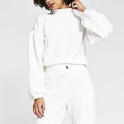 Cream waffle high neck puff sleeve jumper