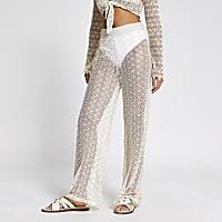 Cream zig-zag knit flared beach trousers
