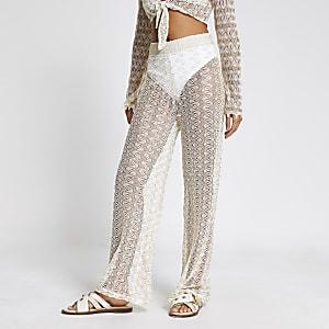 Crèmekleurige met zig-zag patroon gebreide stand broek met uitlopende pijpen