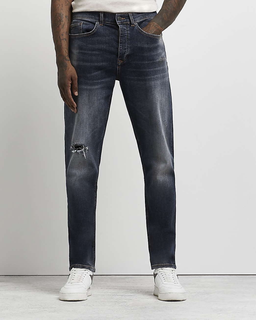 Dark blue ripped relaxed fit jeans
