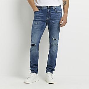 Dark blue ripped Sid skinny jeans