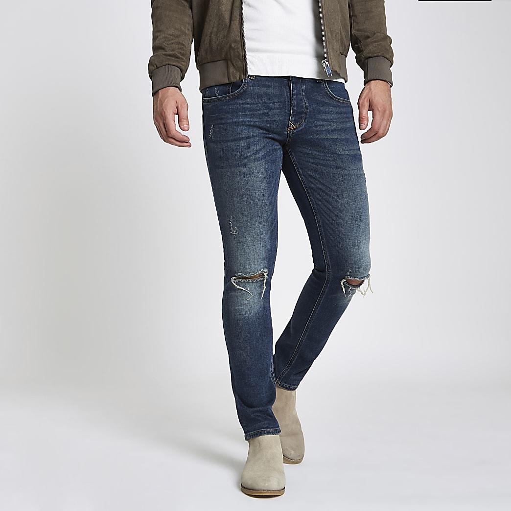 Donkerblauwe skinny geborduurde ripped jeans met zak