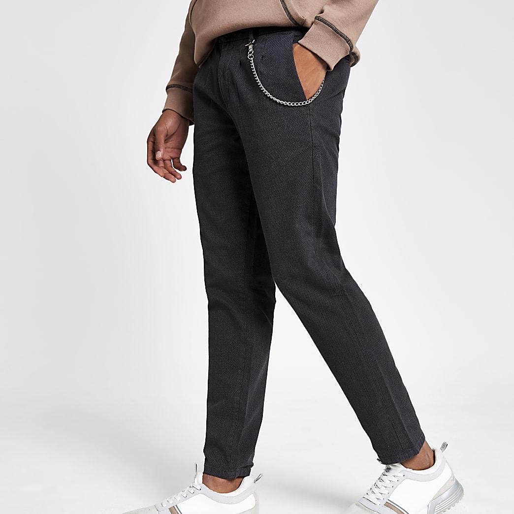 Donkergrijze smaltoelopende broek met ketting