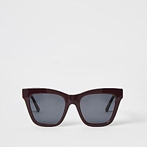 DunkelroteSonnenbrille mit Kettenprägung