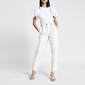 Jeans mit hohem Bund und schmal zulaufendem Hosenbein in Ecru