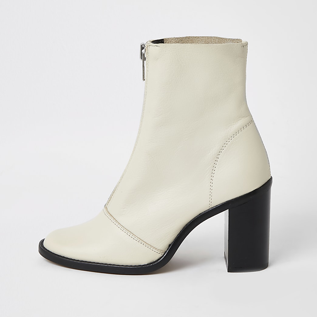 Ecru leather zip front heeled ankle boots
