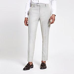 Ecru slim-fit pantalon met textuur