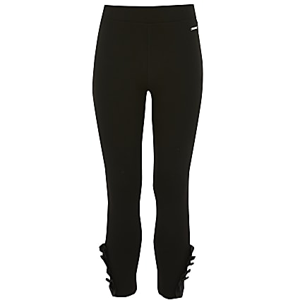 Girls black frill ponte leggings
