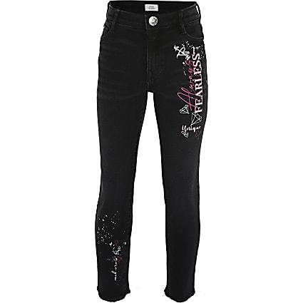 Girls black graffiti straight leg jeans