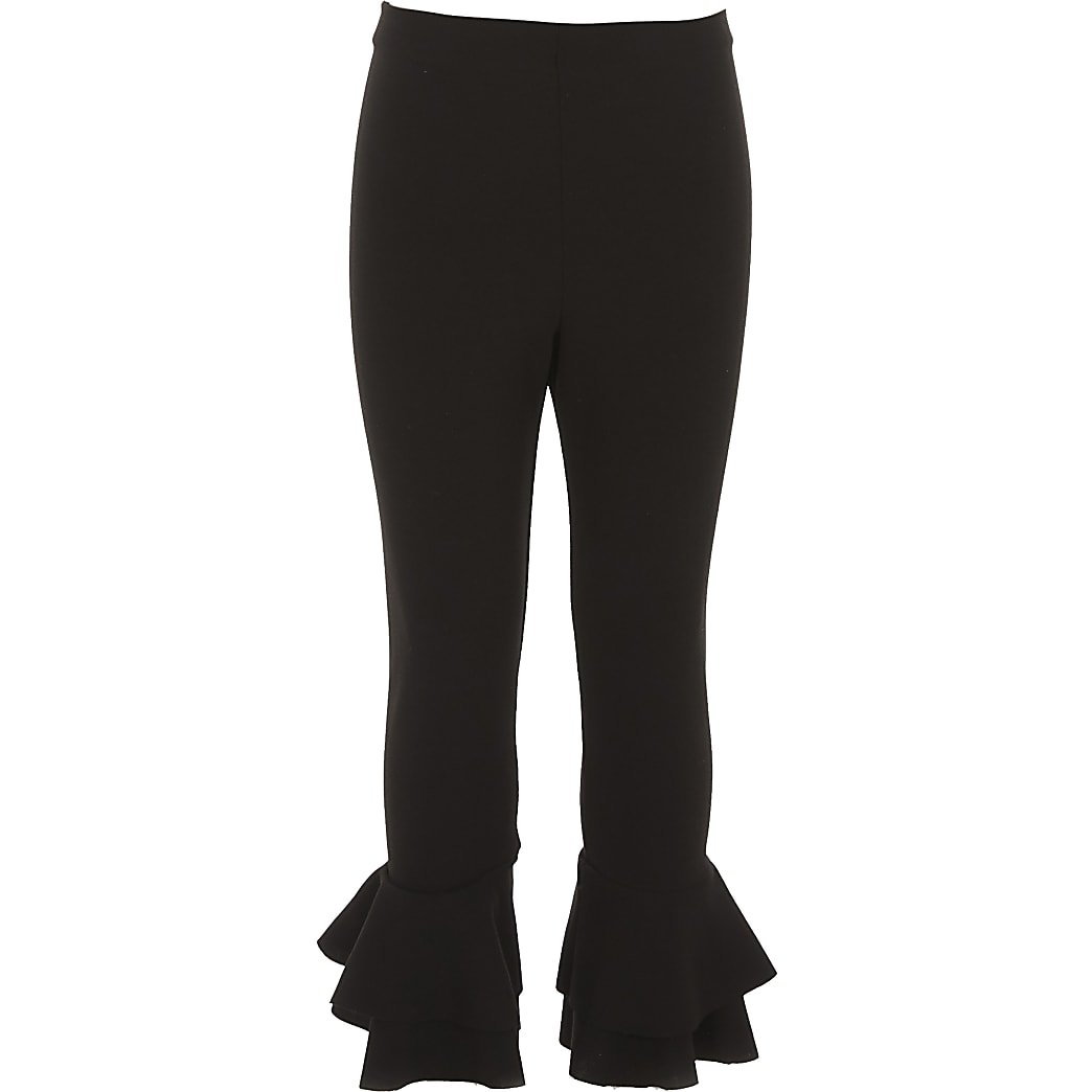 Girls black ruffle hem leggings