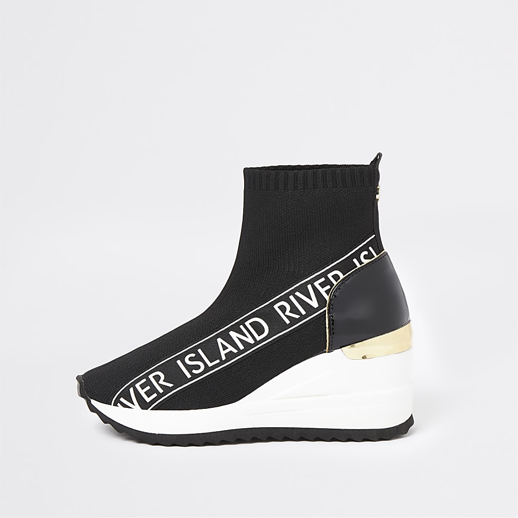 Girls black wedge sock trainer